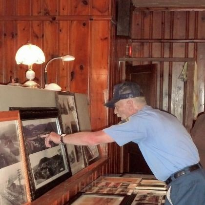 Bolivar_1 Bolivar firefighter Larry Lute looks at old photos that were displayed along with other borough memorabilia at the Bolivar American Legion. He has lived in the borough for 13 years.