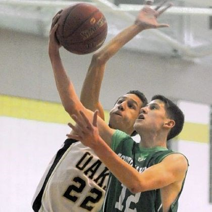 Bonnaure.jpg Keystone Oaks' Braydon Griffiths tries to block South Fayette's Evan Bonnaure, who paced the Lions with 29 points in the win.