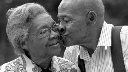 Both 85 Lena Henderson and Roland Davis, both 85, share a kiss July