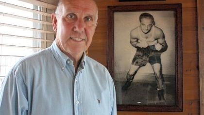 Boxer Bernie Marino, an Irwin resident, stands in front of a photo of his uncle, Tony Marino, who was a world champion boxer in the 1930s.