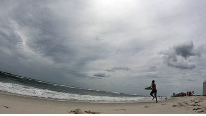 boy plays in surf A boy plays in the surf in waves ahead of Tropical Storm Isaac in Orange Beach, Ala., Monday.