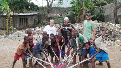 Brad Henderson, Max Talbot and Mike Rupp Penguins chaplain Brad Henderson, Penguins Max Talbot, Mike Rupp and orphans play with plastic hockey sticks during a trip to Haiti in August.
