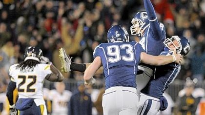 Brandon Hogan West Virginia's Brandon Hogan walks off the field as Connecticut's Dave Teggart, center, celebrates with Derek Chard, left, and Chad Christen after kicking the winning field goal in the overtime Friday in East Hartford, Conn.