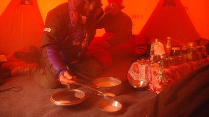 Breakfast on Everest Sir Ranulph Fiennes, whose loud nocturnal use of oxygen keeps his tent mate awake at night, serves breakfast to the sleep-deprived author at Camp 2.