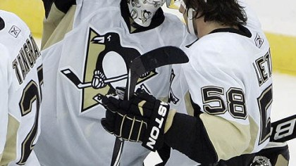 Brent Johnson and Kris Letang Penguins goaltender Brent Johnson is congratulated by defenseman Kris Letang after the Penguins defeated the Devils 3-1.