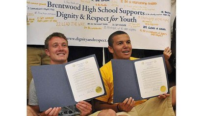 Brentwood and Monessen Brentwood's Sean O'Brien, left, and Monessen's Justice Rawlins, right, pose with proclamations presented to both schools by Brentwood's mayor to mark the schools' efforts Wednesday to combat the conflicts of this past winter.