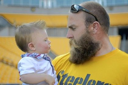 Brett Keisel holds baby Steelers defensive end Brett Keisel holds 1-year-old Sam Bell during an event for veterans Tuesday at Heinz Field. Sam's father, Jason Bell, 29, of Johnstown is an Army veteran and served two tours of duty in Iraq and one in Afghanistan. The 6th annual event was designed to give veterans a chance to meet some of the Steelers and play football with them.
