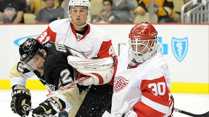 Brett Sterling, Ilari Filppula and Chris Osgood Penguins forward Brett Sterling is stopped by Red Wings goaltender Chris Osgood at Red Wings forward Ilari Filppula defends in the first period of Tuesday's game at Consol Energy Center.