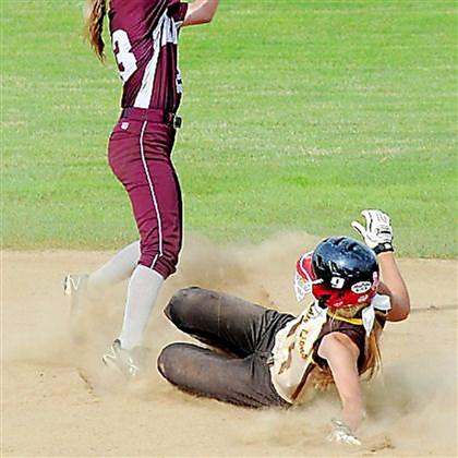 Bridgers Softball Greensburg Salem's Claire Oberdorf slides into second base as Ambridge's Hannah Krokonko takes the throw in WPIAL championship game last week.