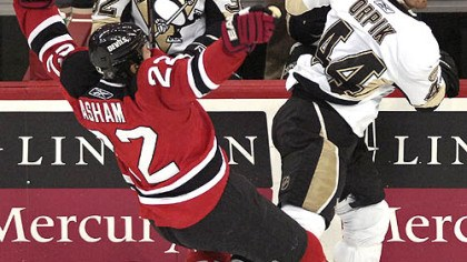 Brooks Orpik The Devils' Arron Asham, left, loses his balance after colliding with Brooks Orpik in the second period last night in Newark, N.J.