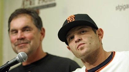 Bruce Bochy and Freddy Sanchez New Giants infielder Freddy Sanchez, right, answers questions as manager Bruce Bochy smiles during a news conference at AT&T Park in San Francisco yesterday.