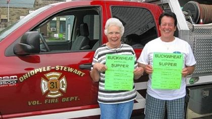 Buckwheat Supper Sara Ann Grover and Jim Meyers, representing the Ohiopyle-Stewart Volunteer Fire Co. and Ladies Auxiliary, hold signs advertising the Buckwheat Supper in front of the company's new brush truck.