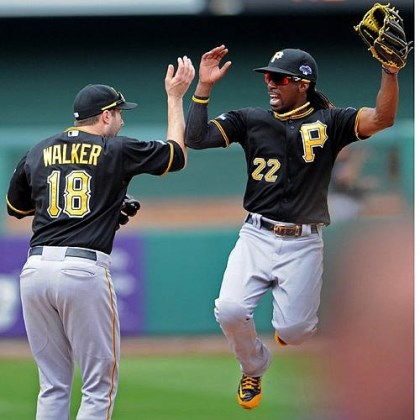 bucs game 2 high five Neil Walker and Andrew McCutchen celebrate after defeating the St. Louis Cardinals.