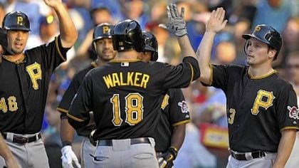 Bucs Trade Pittsburgh Pirates'' Garrett Jones and Travis Snider right, congratulate Neil Walker after his grand slam against the Chicago Cubs.