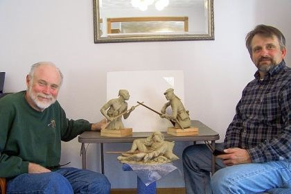Bushy Run Artist Robert Griffing, left and sculptor Wayne Hyde, both of them from Bedford, display models that Mr. Hyde will expand into a large sculpture to commemorate the 250th anniversary of the Battle of Bushy Run. The historic battlefield is located in Penn Township, Westmorealnd County. Mr. Griffing made the models. Mr. Hyde will create a bronze sculpture 8 1/2 feet long and 9 feet high.