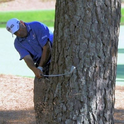 cabrera Angel Cabrera is forced to hit from behind a tree Saturday. He still managed to shoot a second consecutive 69 at Augusta National and force his way into a share of the lead.
