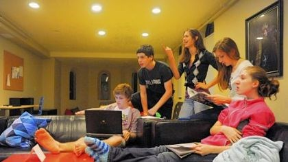 Cameron Clark works on his computer Cameron Clark, left, works on his computer as, from left to right, Seth Klein-Tooley, 13, Alyssa Drake, 16, Erin Young, 17, and Aidan Schubert, 16, watch television in a common room at the Pittsburgh Ballet Theatre's Byham house for out-of-town students.