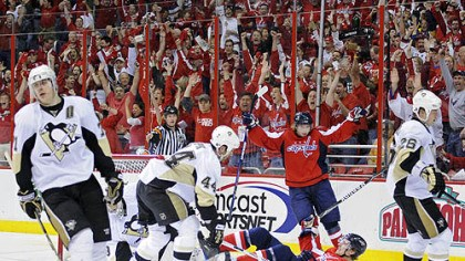 Capitals celebrate Penguins center Evgeni Malkin, left, had just two shots on Capitals goalie Simeon Varlamov and was on the ice for both of Washington's even-strength goals.