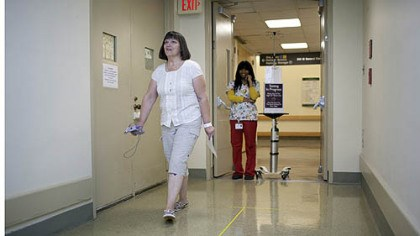 CardioFit clinical trial Brenda Warner, of Tyrone, Pa., participates in a walk test Tuesday as part of the CardioFit system clinical trial at Allegheny General Hospital. Warner is the first person in to receive the CardioFit implant as part of the trial.