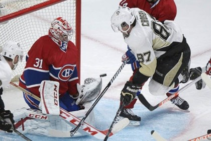 Carey Price and Sidney Crosby Montreal Canadiens goaltender Carey Price makes a save against the Penguins' Sidney Crosby during the second period.