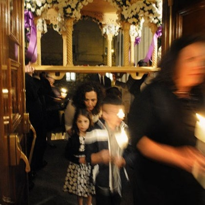 Carla Antoniades and her children at Good Friday worship Carla Antoniades and her children Gina, 5, and Anthony 8, of Moon Twp., walk beneath the symbolic flowered tomb of Jesus Christ.