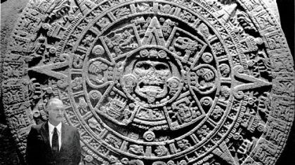 Carlos Fuentes Carlos Fuentes stands next to the Aztec calendar in the National Museum of Anthropology in Mexico City.