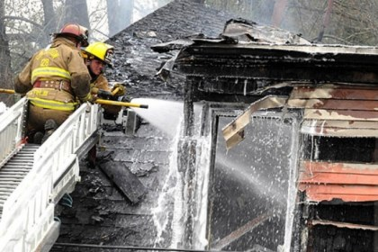 carnegie house fire Firefighters hit the hot spots on the upper floor of a home on Howard Street in Carnegie today.