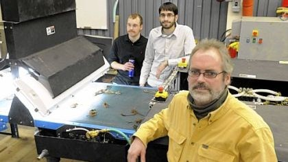 Carnegie Mellon University's National Robotics Engineering Center Chris Fromme, front, the principal investigator of the strawberry plant sorting project of Carnegie Mellon University's National Robotics Engineering Center, Ben Koopman, left, software engineer and Rich Pantaleo, mechanical engineer, are developing this robot to evaluate the growth of strawberry plants.