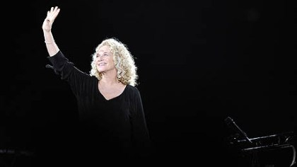 Carole King waves Carole King waves to the audience at her concert at the Mellon Arena.