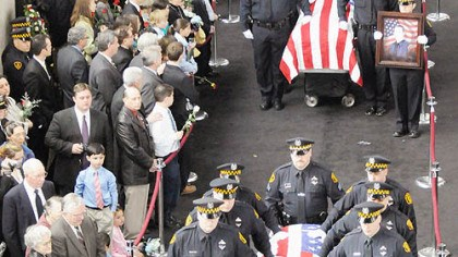 Carrying the caskets Pittsburgh Police pallbearers carry the caskets of slain officers, from front, Stephen J. Mayhle, Paul J. Sciullo II and