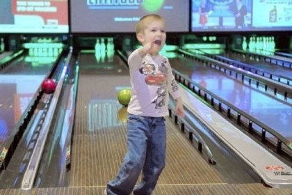 Carter Wilson-Reilly Carter Wilson-Reilly, 4, celebrates getting his ball rolling down the middle of the lane Sunday as he bowls with other special needs children and their parents belonging to the PALS program during a bowling and pizza party at Latitude 40 at The Pointe shopping center in North Fayette.