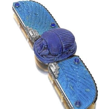 Cartier belt buckle Cartier made this belt buckle around 1926 out of faience, enamel, sapphires, and diamonds.