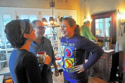 Catherine Mistick and Joseph Mistick Catherine Mistick, left, and her husband, Joseph Mistick, center, talk with Lori Comber, a friend and runner from Mt. Lebanon, during a breakfast at the Mistick home.