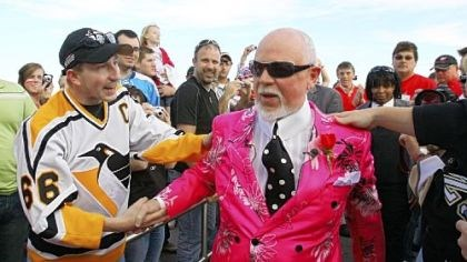 CBC analyst Don Cherry CBC analyst Don Cherry, sporting a customary loud outfit, greets a Penguins fan as he enters Joe Louis Arena for last night's Game 2 in Detroit.
