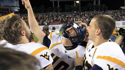 Celebration West Virginia's Tyler Bitancurt (40) celebrates with teammates after kicking the game-winning field goal in West Virginia's 30-27 win over South Florida last night in Tampa.