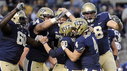 Celebration Pitt players smother kicker Dan Hutchins after he won the game on a field goal at the end of the fourth quarter against Connecticut last night at Heinz Field.