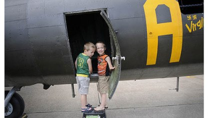 Charles and Eric Tomovcsik Charles and Eric Tomovcsik of McKeesport check out the Memphis Belle.