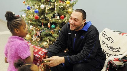 Charlie Batch Steelers player Charlie Batch gives a present to Shaterra Lee, 5, who is at the Salvation Army with her mother as part of the Best of the Batch Foundation activities.