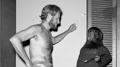 "Charlton Heston on the set of 'Planet of the Apes' Billy Curtis, in a gorilla costume, chats with Charlton Heston on the set of ""The Planet of the Apes,"" in 1967."