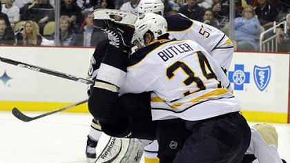 Chris Kunitz Penguins forward Chris Kunitz is upended by Sabres defenseman Chris Butler in the third period of Tuesday's game at Consol Energy Center.