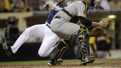 Chris Snyder and Ryan Ludwick Pirates catcher Chris Snyder waits on the late throw as the Padres' Ryan Ludwick slides safely in the third inning Tuesday at Petco Park.