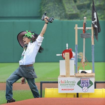 Christian Tsu-Raun Christian Tsu-Raun celebrates as the Children's Museum debuted a machine known as a trebuchet, a mechanical device to throw out the ceremonial first pitch on Sunday.