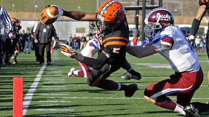 clairton bears win Clairton's Terrish Webb dives into the end zone for a touchdown against Dunmore's John Rinaldi in the PIAA class A championship at Hersheypark Stadium Friday.