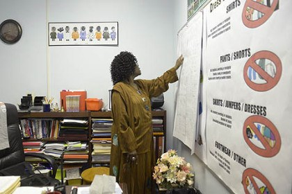 Clairton principal Clairton associate principal Deborah Marshall goes over a truancy chart displayed this spring on her office wall.