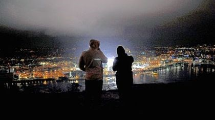 Classic light show A man and a woman look out over a lit Heinz Field hours before the start of the Winter Classic from Mt. Washington last night.