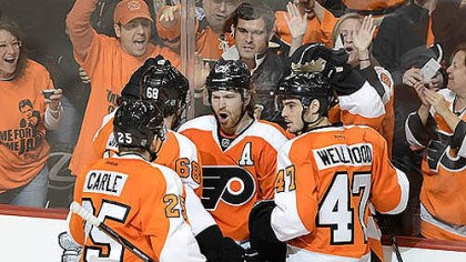 Claude Giroux Claude Giroux, center, celebrates after scoring 32 seconds into Game 6 Sunday in Philadelphia.