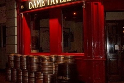 Closing time At closing time in Dublin's touristy Temple Bar region, a day's worth of empty kegs are piled outside a pub.