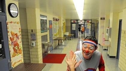 Clown Mike Matters high-fives Clown Mike Matters high-fives a student Monday at Phillips Elementary School