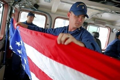Coast Guard Also on the cutting board Chief Petty Officer Sean Keeman of the U.S. Coast Guard cutter Hawksbill folds an American flag while on patrol Thursday in the Pacific Ocean off the coast of San Francisco. The Coast Guard is facing more than $400 million in sequester budget cuts that will reduce patrols by 25 percent.
