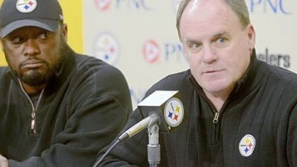 Colbert General manager Kevin Colbert, right, and Coach Mike Tomlin speak to the media before the NFL draft last spring.